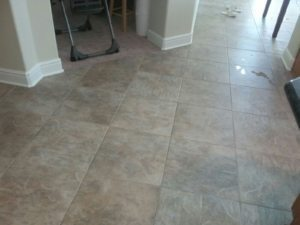 very light grout lines with spill stain being worked on